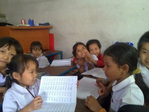 Spelling class with girls at Hsa Htaw Learning Centre